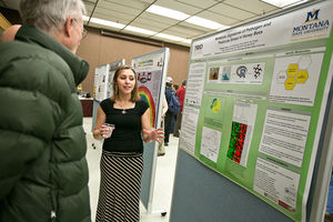 Madison Martin, a senior majoring in microbiology and a McNair Scholar at Montana State University, presents her research on impact of pathogen and pesticides on bees, Tuesday, Dec. 2, at MSU.