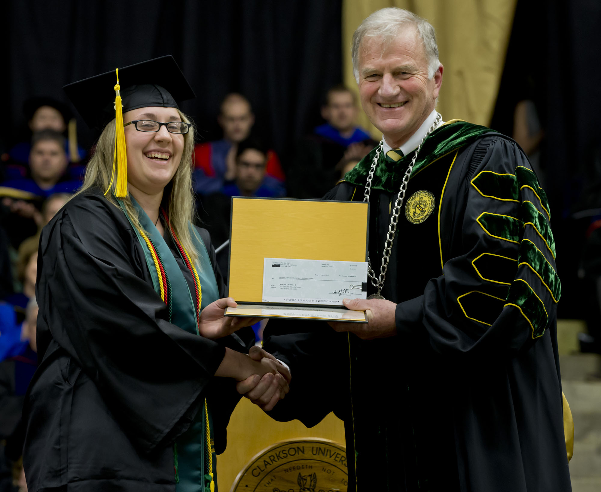 Clarkson University President Tony Collins (right) presents the Levinus Clarkson Award to Victoria Kocsis.